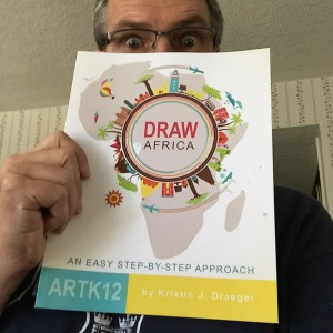The husband of Kristin holding Draw Africa