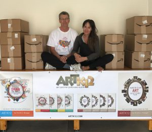 Kristin and The Husband with boxes of ARTK12 books