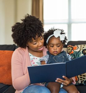 Mother reading to a toddler