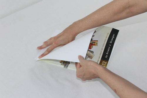 Carefully tear the book apart. This works best if you tear half the pages out from the front, then flip it over and tear the rest out from the back.