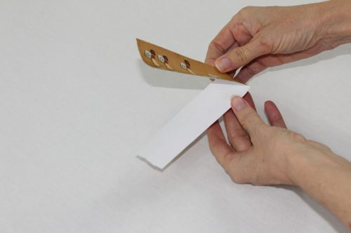 Fold the book mark in half.