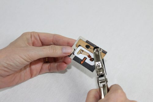 Punch a hole in the corner of the card.